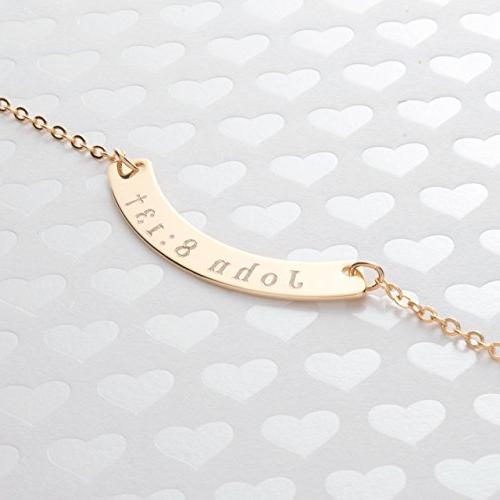 a curved name necklace diamond